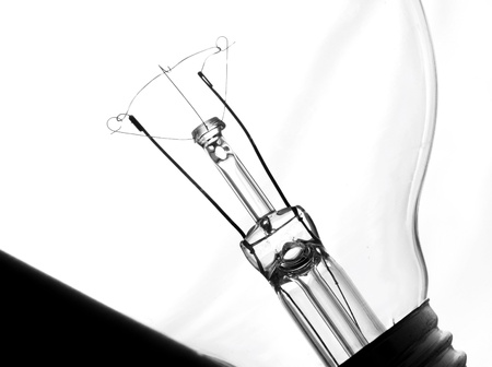 Close up isolated image of light build bulb silhoutte Stock Photo