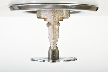 Close up image of fire sprinkler on white. Fire sprinklers are part of an integrated water piping system designed for life and fire safety. Reklamní fotografie
