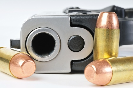 Close up image of 40mm pistol with bullets