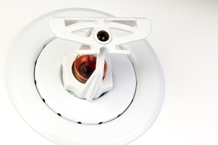 Close up image of fire suppression sprinkler on white