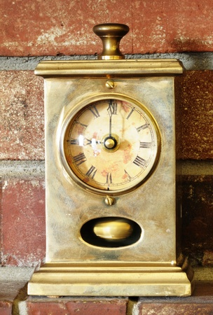 Image of antique clock on brick background