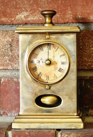 Image of antique clock on brick background