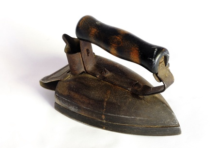Image of retro  antique iron on white background