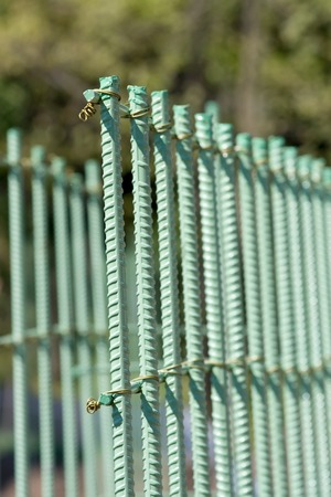 rebar: Green painted rebar in vertical with twisted wire ties Stock Photo