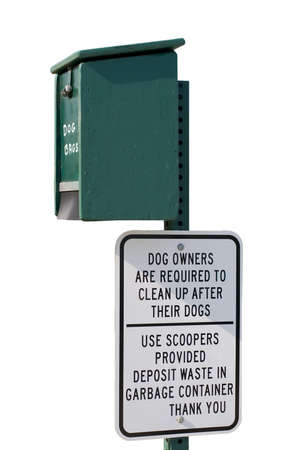Sign and container reminder to clean up after ones dog photo