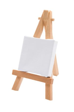 A blank stretched artists canvas on an easel