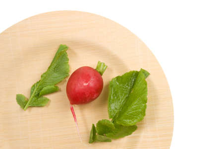 pungent: Radish and leaves on an environmentally friendly bamboo plate
