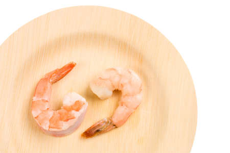 decapod: Two cooked Shrimps on an environmentally friendly bamboo plate Stock Photo