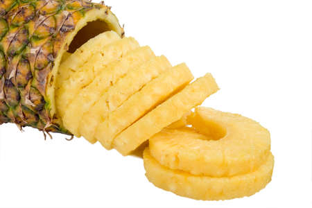 A fresh cut pineapple slices spilling from the center of the fruit photo