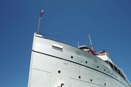 ship bow: The bow of a 1907 Great Lakes Steam Ship against a deep blue sky Stock Photo