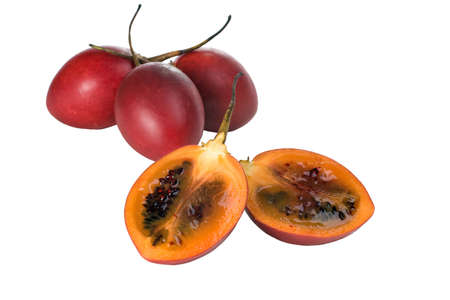 tamarillo: Whole and halved fresh Tamarillo fruit showing its deep red seeds and tangy sweet flesh