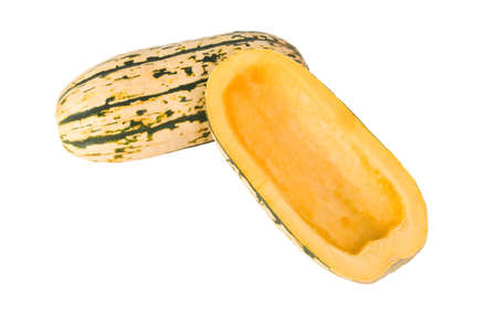 A Delicata squash split open and cleaned out ready for cooking