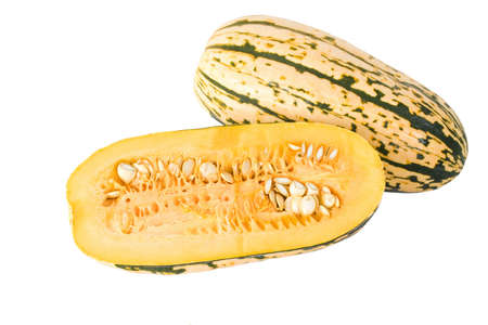 pulp: A Delicata squash split open to show its seeds and inner pulp