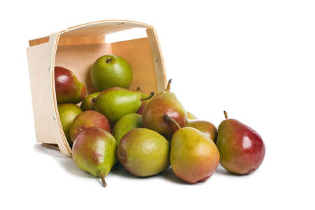 Fresh Seckel Pears spilling from a wood pint box Imagens