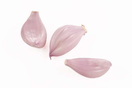 Three fresh shallot offsets isolated on white
