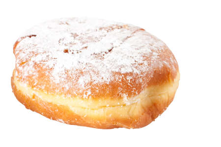 A single fresh powder sugar covered Polish doughnut called Paczek