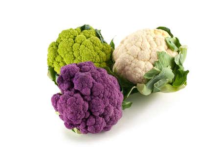 Purple, green and white heads of fresh cauliflower