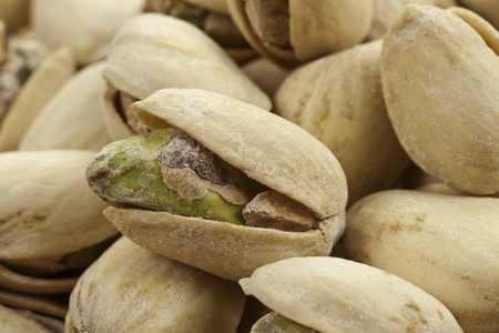 A pile of roasted salted pistachios one close-up showing it Imagens