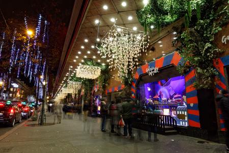 paris france december 4 2017 christmas lights on haussmann boulevard and parisian