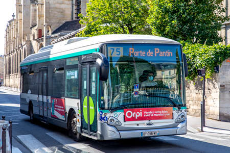 Paris, France - May 26, 2020: Public bus driver wearing surgical mask during the lock down coronavirus covid-19 quarantine Editorial