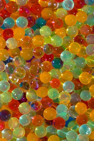 Lots of different colored hydro-gel balls. Set of multicolored orbis. Crystal water beads for games.from above ideal for backgrounds or textures Banque d'images
