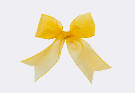 nice yellow ribbon isolated on white background for christmas ornament or gift decoration