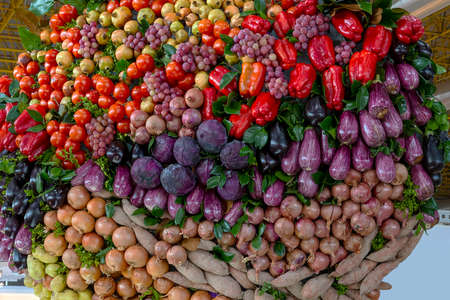 vegetables and fruits placed in a decorative way combined together creating a multicolored spectacle.
