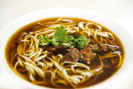 Hot bowl of beef noodles photo