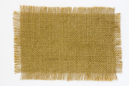 patch: Burlap Canvas with frayed edges on white background.  Stock Photo
