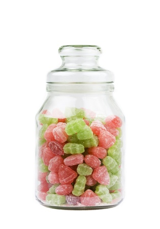 glass jar: Glass Jar of candy sweets over white