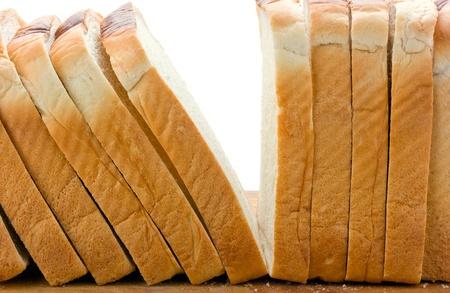 bread loaf: Fette di pane su bianco Archivio Fotografico
