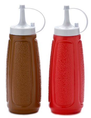 Two plastic sauce bottles brown and red on white background. photo