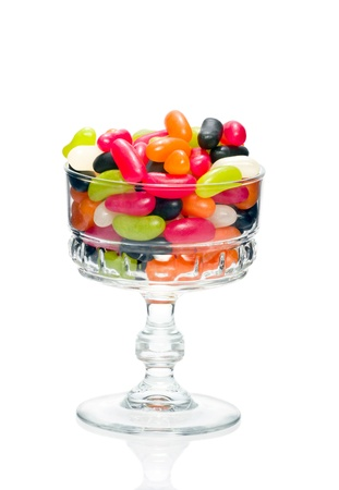 large bean: Jelly bean sugar candy snack in stylish crystal glass bowl isolated on white Stock Photo
