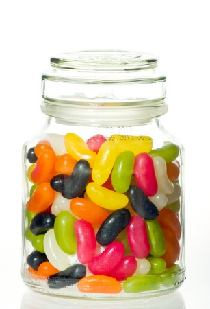 Jellybeans in a glass jar with white background photo