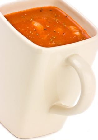Tomato and  soup with thyme rosemary and cracked black pepper. photo