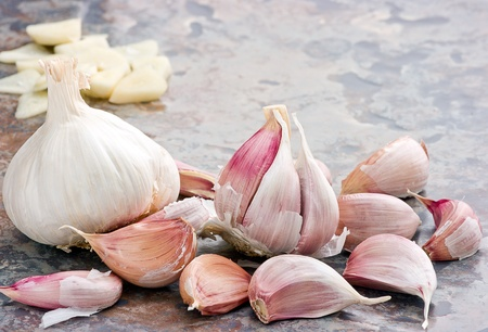 Garlic display on textured tile background with copy space  photo
