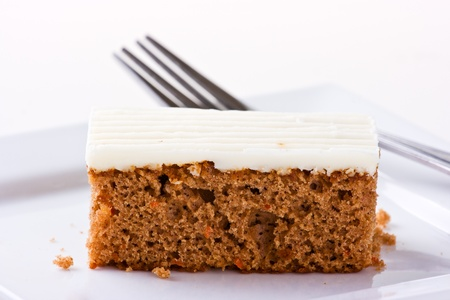 sallow: Carrot Cake on white plate with fork  Isolated on white  Sallow depth of field Stock Photo