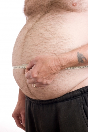 chest hair: Obese male with measuring tape around stomach