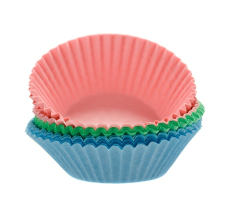 molds: small stack of pastel coloured cupcake baking cups