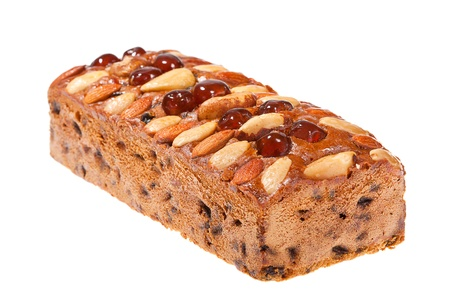 fruitcake: Fruitcake topped glace cherries, whole almonds and Brazil nuts