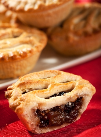 mincemeat: Christmas Mince pies stacked on a plate shallow depth of field  Focus on front open pie  Stock Photo
