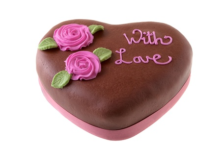 Heart shaped Chocolate Cake Topped with icing sugar flowers and with love words. photo