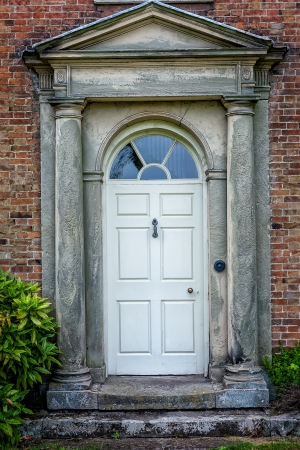 Traditional English victorian front door. Surrounded by  double columns. photo