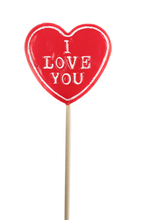 lolly pop: heart shaped lolly pop with on white background. I love you