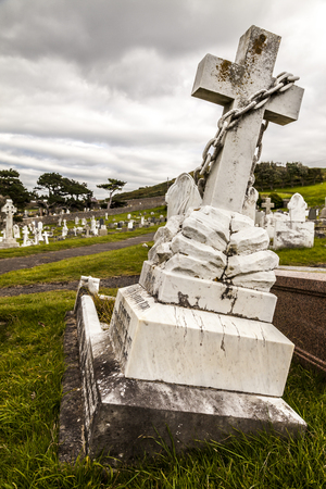lopsided: Graves at Great Orme cemetery. Llandudno North Wales Great Britain United Kingdom. Stock Photo