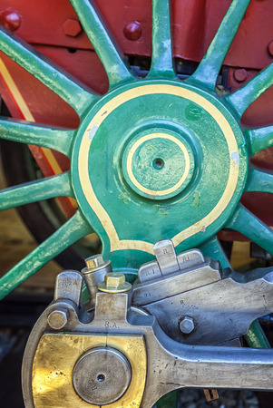 spokes: Close up view of locomotive wheel spokes  and metal parts
