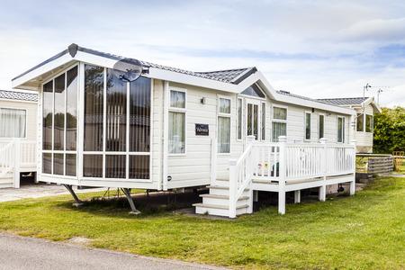 typically british: Prestatyn, Gorant, Wales Great Britain, UK- May 21 2016 :Static caravan holiday homes at a U K holiday resort. Prestatyn Sands North Wales. Editorial