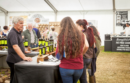 the royal county: The Royal Cheshire County Show,  Knutsford , England, UK. - June 22, 2016  Young women sampling infused oils from a market stall at The7 Royal Cheshire County Show.Ground. Knutsford , England, UK