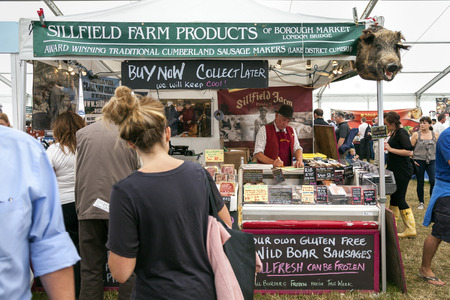 the royal county: The Royal Cheshire County Show,  Knutsford , England, UK. - June 22, 2016  Sillfield farm products market stall with wild boars head at the Royal Cheshire County show, Cheshire, England. Editorial