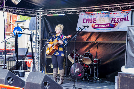 entertainer: Newcastle under lyme United Kingdom - May 5, 2014 : Entertainer  Hollie-May Beeston perfuming on stage  at the Lymelight Festival. Newcastle Under Lyme, Staffordshire, England.
